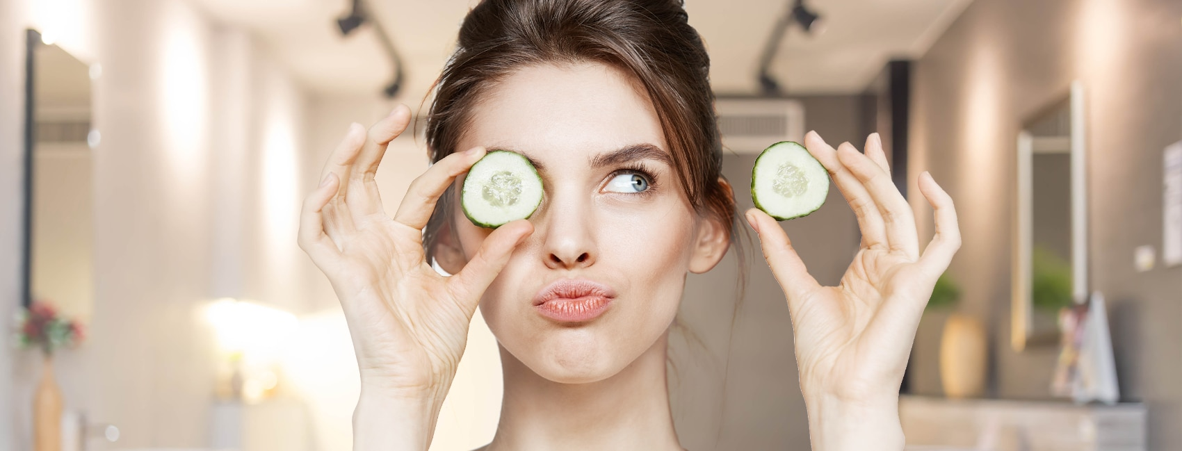 A girl putting cucumber slices on her eyes in a bathroom setting