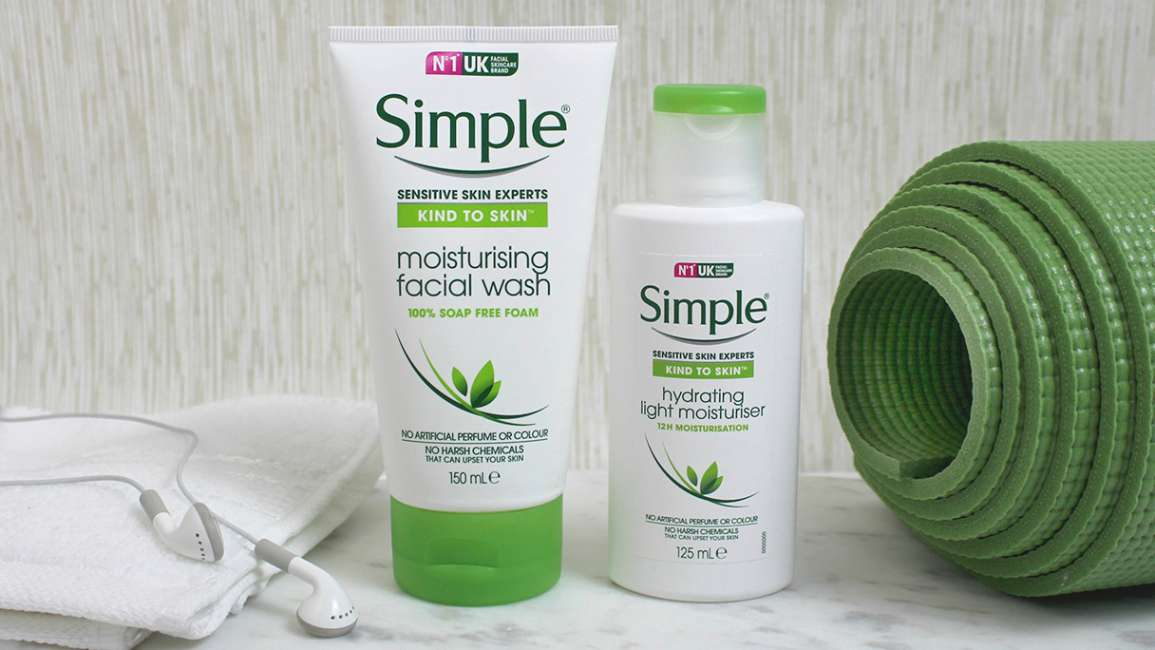 Simple Moisturising Facial Wash and Hydrating Light Moisturiser alongside a green yoga mat and headphones