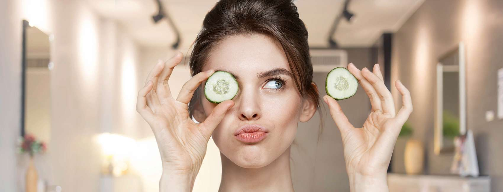 How to apply your skincare products correctly holding cucumbers at her