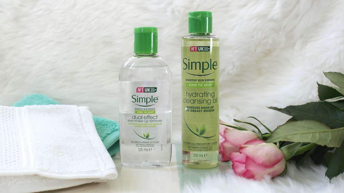 Simple Facial Cleansing Oil and Simple Dual Effect Eye Make-Up Remover with a notebook and rose.