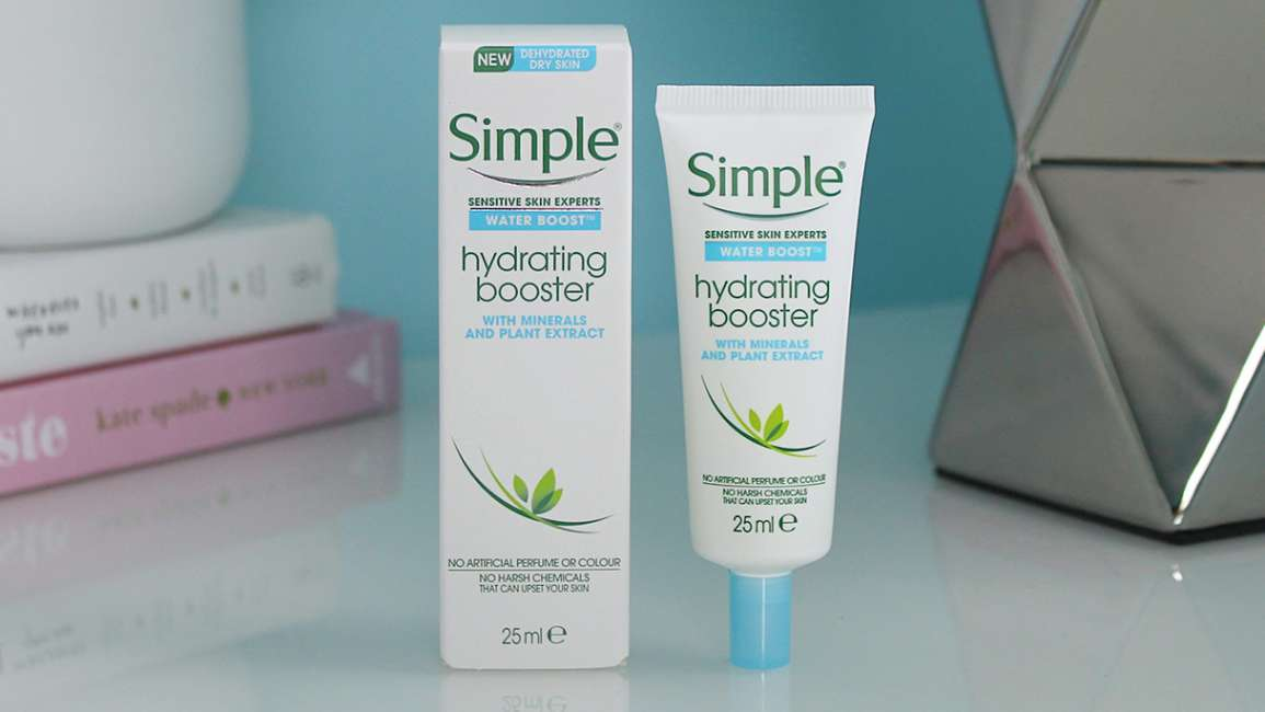 Simple Water Boost Hydrating Booster with its box on bedside table