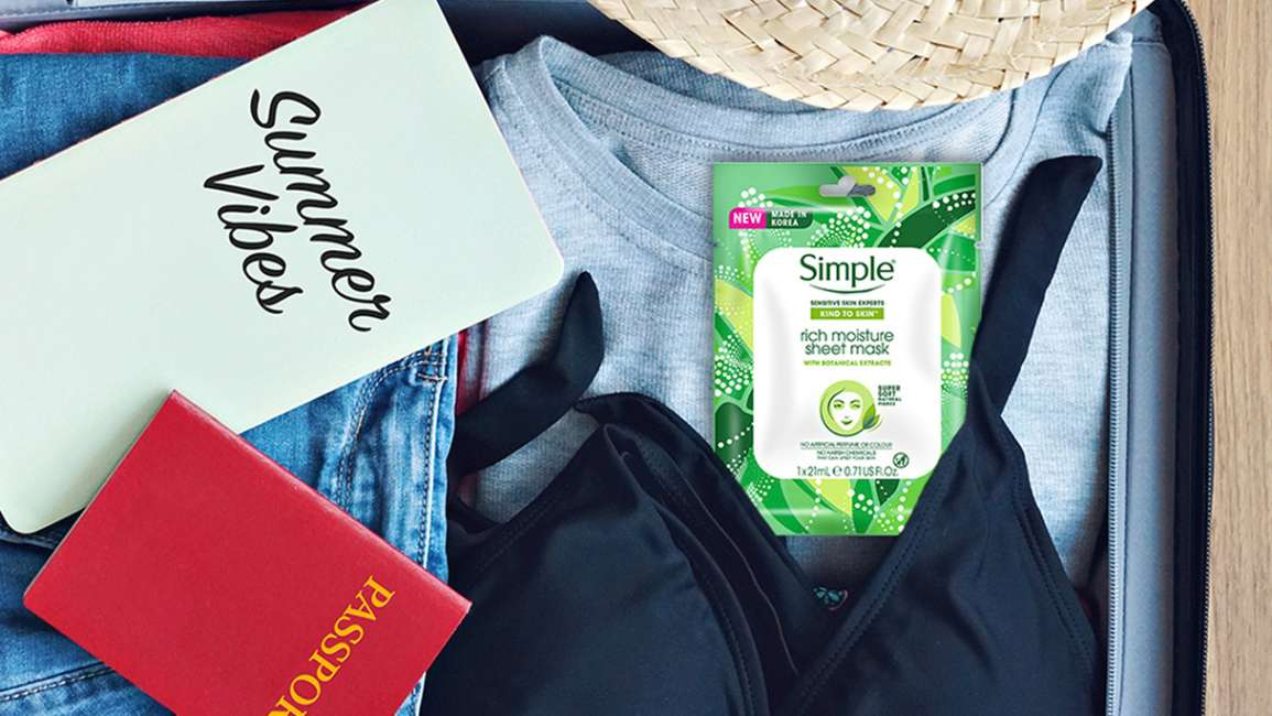 Open packed suitcase including Simple Rich Moisture Sheet Masks