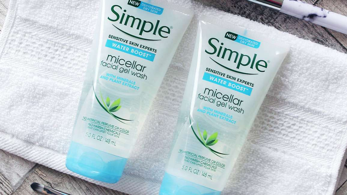 Two tubes of Simple Water Boost Micellar Facial Wash Gel on a face cloth