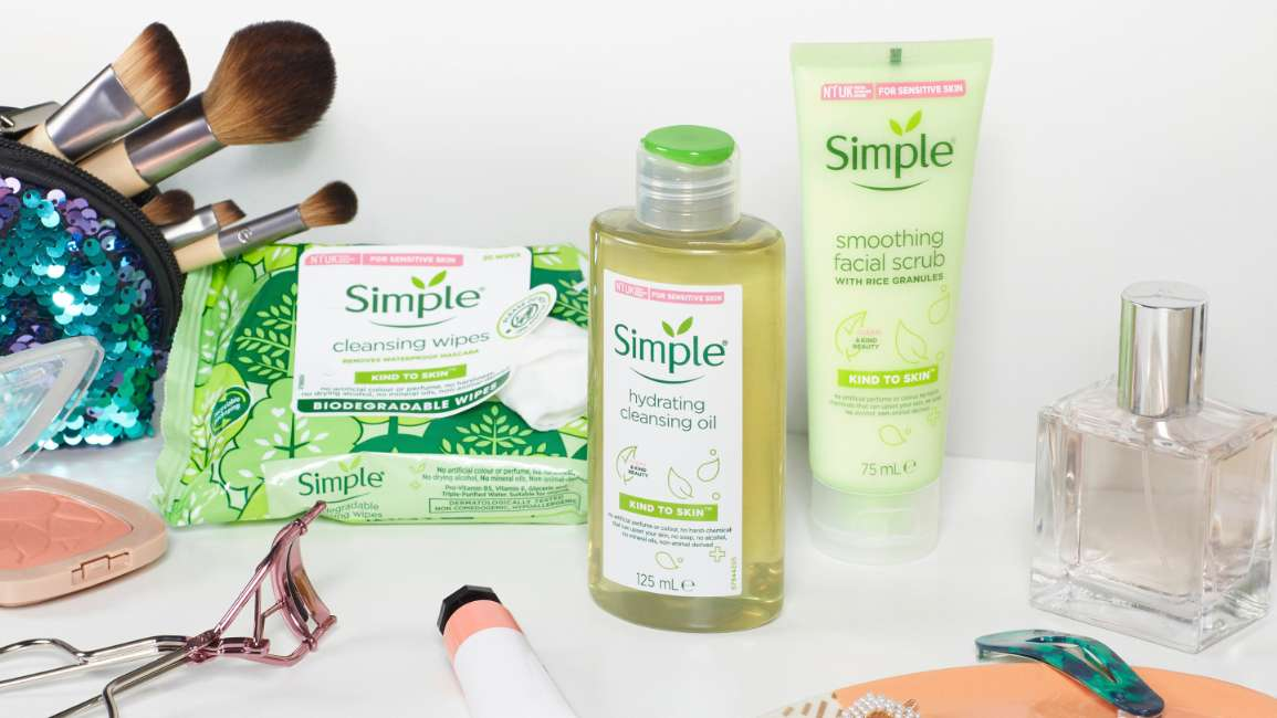 Simple Facial products with make up brushes and make up in a bathroom setting